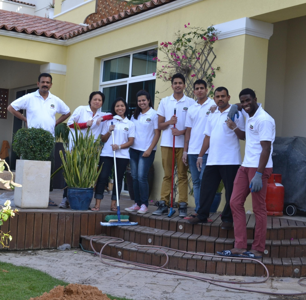 Associates from Courtyard by Marriott Dubai Green Community busy at work assisting the local community to clean up their homes
