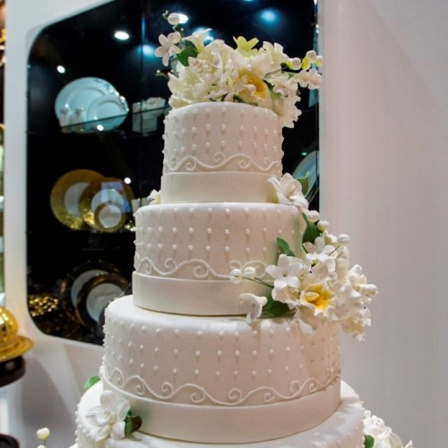 For Royal Catering, the wedding cake is as much a dessert as a piece of art and entertainment