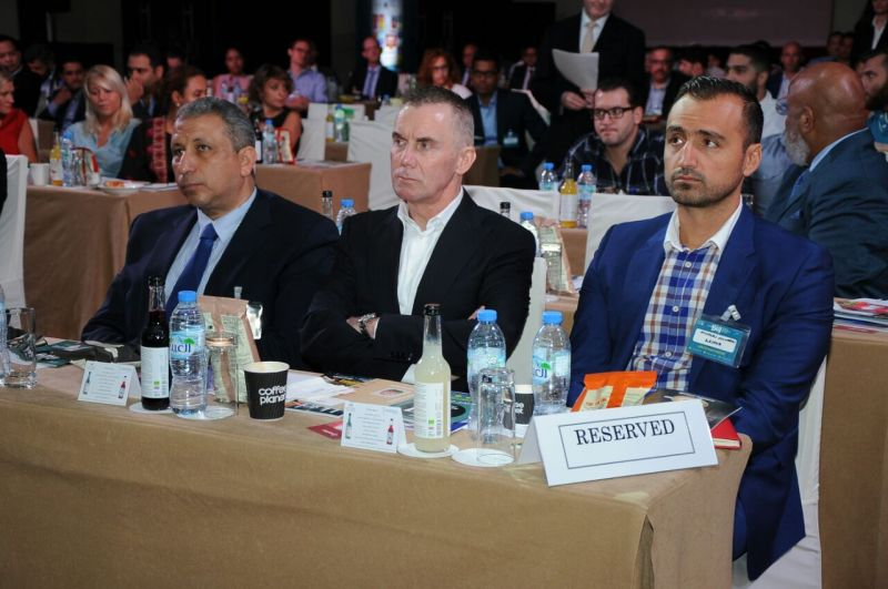 Gary Rhodes, Nicholas Couvaras and Dr. Basem in the front row of the audience at forum