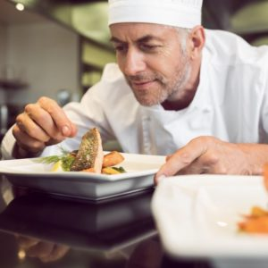 Chef plating up a culinary creation