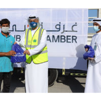 Dubai Chamber distributes 400 food packs to the emirate's creek sailors